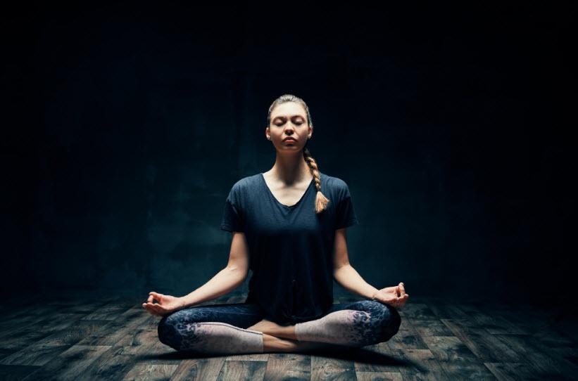 meditating in dark room